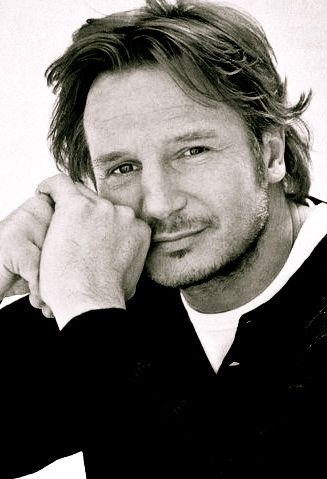 Liam Neeson...tall, dark, and Irish...it suits him just fine. Male actor, long hair style, hands, cute smile, portrait, photo b/w.