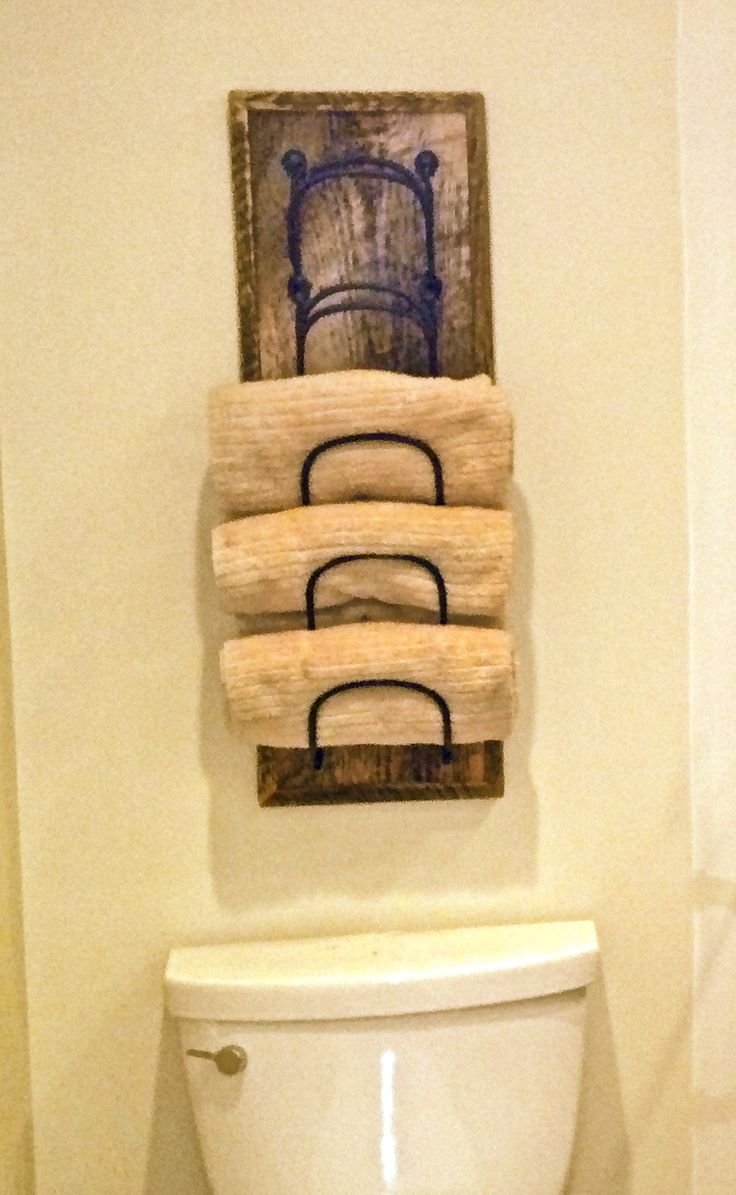 Small rustic bathrooms - Hang Rolled Towels On Wall Behind Toilet In Guest Bath