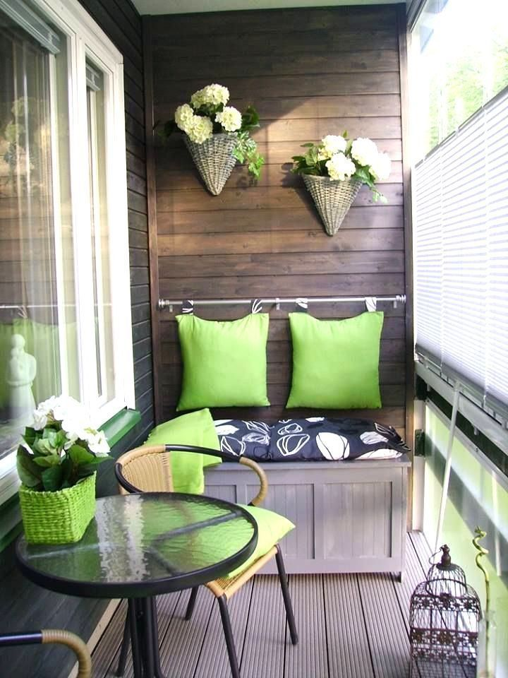 Even if your porch, deck or balcony is small, you don't have to sacrifice style or comfort. Here, a storage trunk topped with a cushion and backed with pillows hung from a curtain rod, doubles as seating. Lime green accents pull it all together. | Via decoratingyoursmallspace.com