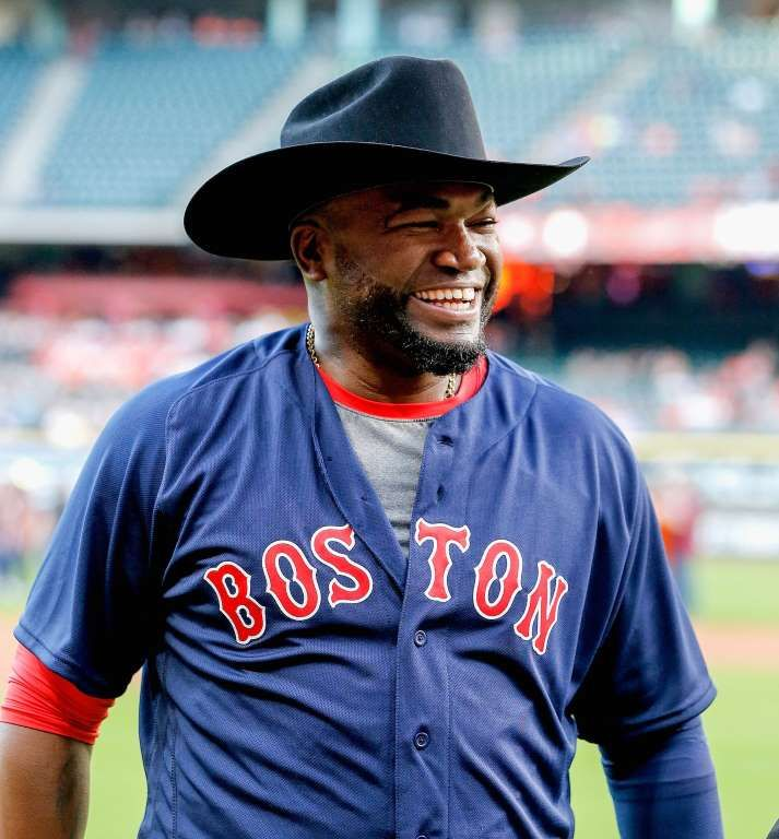 Everything's bigger in Texas: David Ortiz of the Boston Red Sox receives a Stetson cowboy hat as a gift for his upcoming retirement from the Houston Astros at Minute Maid Park in Houston on April 22. - © Bob Levey/Getty Images