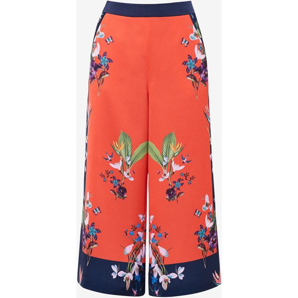 Tropical Oasis culottes ($94) ❤ liked on Polyvore featuring pants, capris, red trousers, mid rise pants, red pants, loose fit pants and cut loose pants