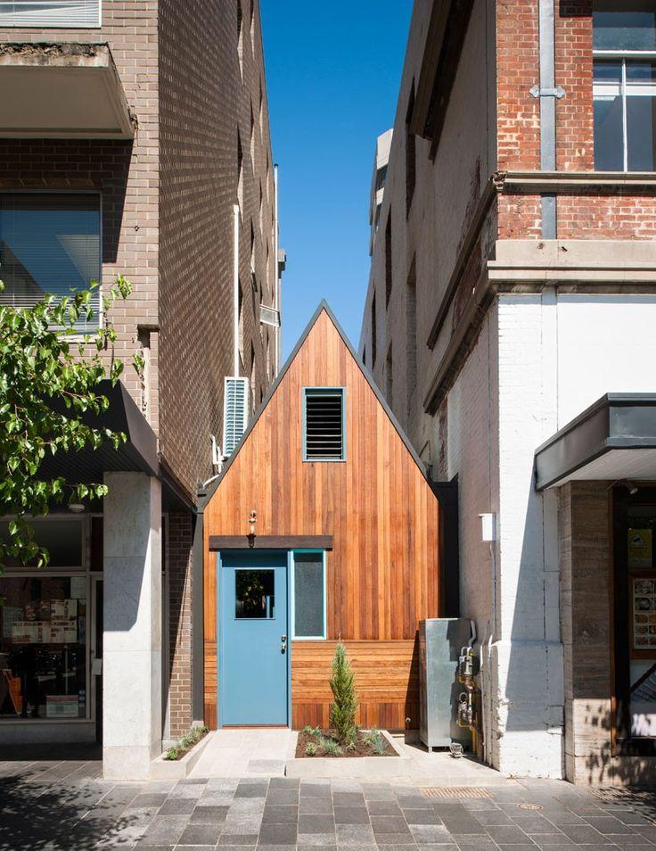 sans-arc studio tucks pink moon saloon into alleyway