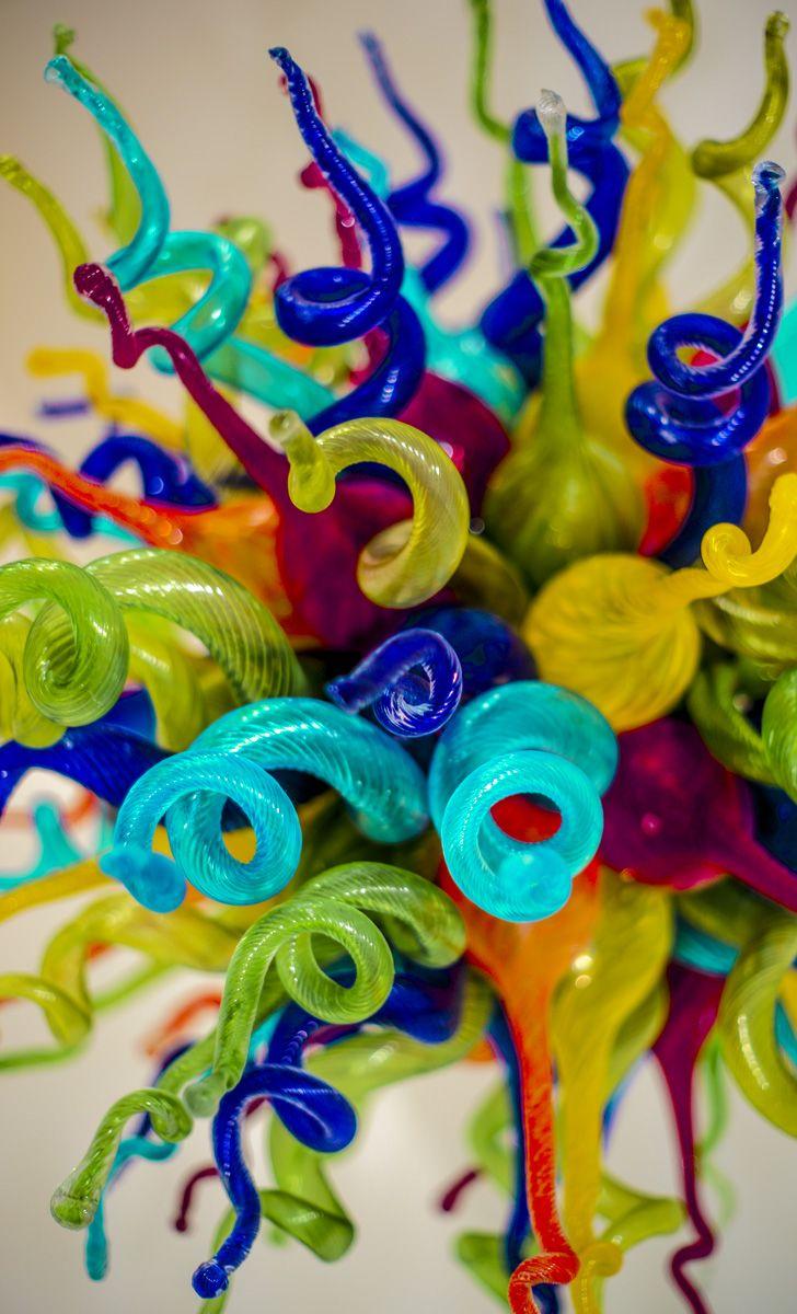 Design: Interiors by Christina llc.  Wonderful Glass Art Chandelier christinarayinteriors.com