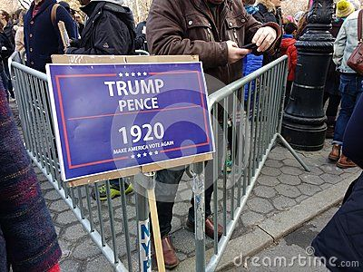 This sign at the Women`s March plays on Donald Trump`s 2016 presidential campaign slogan, `Make America Great Again!` by instead saying, `Trump, Pence 1920 Make America Vote Again`. This photo was taken on January 20th 2018.