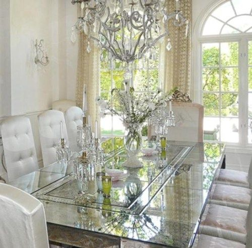 I love the monochromatic color scheme and all the sparkle from the abundance of natural light touching the glass/mirror table and crystal chandelier.  So elegant.