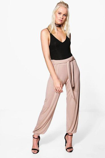 Iman Tie Waist Jersey Hareem Trouser by Boohoo. Trousers are a more sophisticated alternative to skinniesTrousers take on a realxed silhouette for the new season, with sports tailoring setting the trends and the wide leg one to watch. Pick printed palazzo pants for a dramatic day time... #boohoo #pants