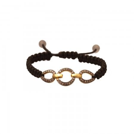 Three diamond links intricately woven, forms this versatile bracelet. Perfect for a night out as well as the office.