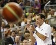 U.S.Olympic basketball coach Krzyzewski applauds his players during an exhibition game against Spain ahead of the 2012 London Olympic Games in Barcelona