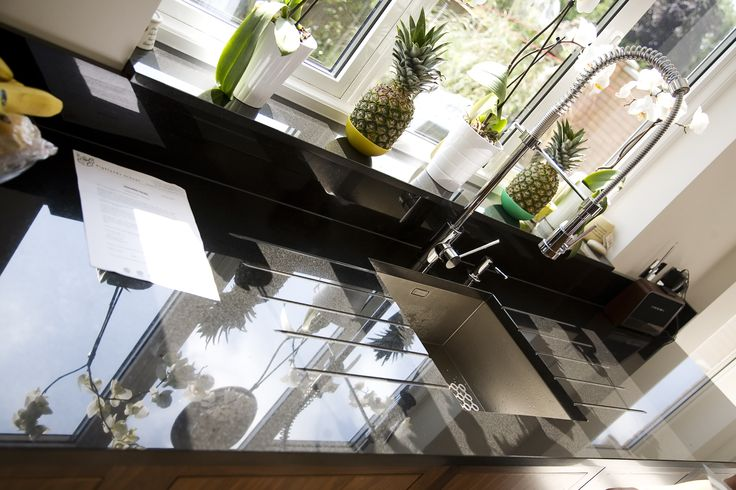 Black granite kitchen worktops by The Marble Store. Your choice of kitchen worktops are the final touch to your new kitchen and the contrast of black worktops against contemporary units will create an amazing effect.  Black granite is famous for its shine and mirror like appearance, making it an obvious choice for a perfect kitchen.  It has all the qualities of a typical granite such as low maintenance, hard wearing and durable, scratch, moisture, mould and heat resistant.