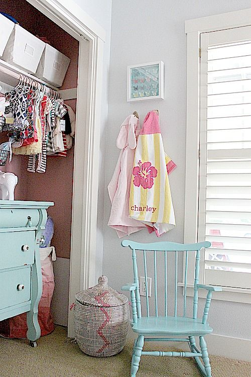 dresser in closet, cute matching chair, towel hooks in baby's room, painted closet