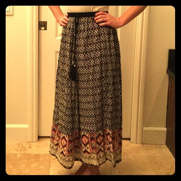 Batik Skirt Long batik skirt. Elastic waist with decorative, beaded, tassel tie front (not a functional draw string). Light weight, flowy, and very comfortable. In great condition. Angie Skirts Maxi