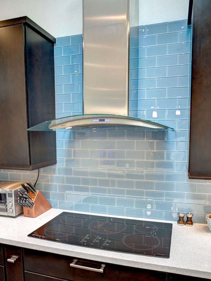 HGTV: This Contemporary Kitchen Boasts A Beautiful Glass Tile Backsplash  With A Custom Grout. The Stainless Exhaust Hood Reflects The Curves Of The  Island.