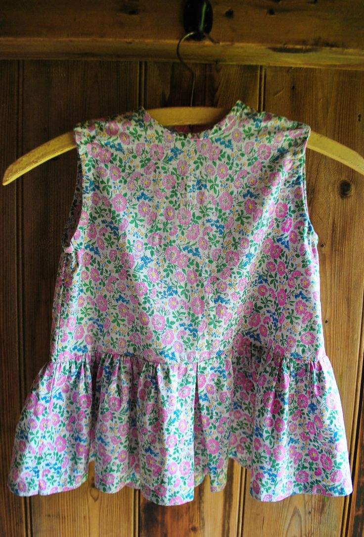 Handmade vintage 1960s floral dress Age 3-4 £12 Delightful handmade pink, blue, and yellow floral patterned dress with a drop-waist, and pink zip to the rear.  Circa 1965 Beautifully made and in wonderful condition (I wish I could sew like this). Child age 3-4 years.