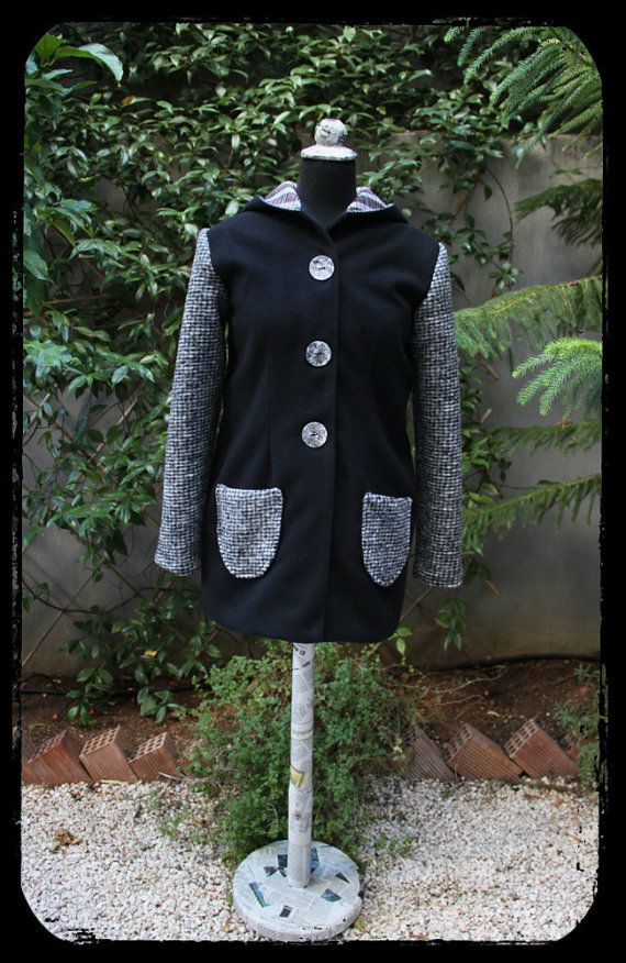 """Black wool coat with grey sleeves, grey coconut buttons and a large handmade crochet pin brooch on the pleat on the back , by """"Eating the Goober"""""""
