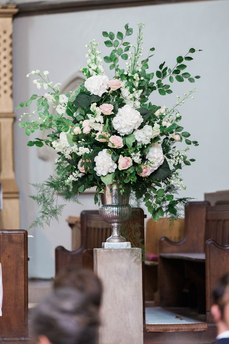 Church Floral Arrangement - Lucy Davenport Photography | English Country Garden Marquee Wedding | Essense Wedding Dress | Pink Multiway Bridesmaid Dresses