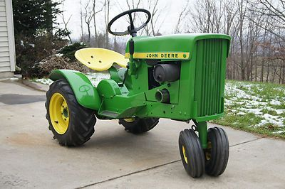 1965 John Deere Garden Tractor... gotta figure out how to do this but keep the belt drive for the mower deck. Then build a crawler oug of another one to plow snow.