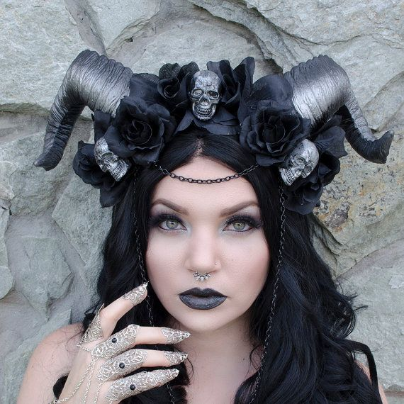 This gothic horned headdress has hand painted lightweight horns, black roses, small skull accents and black chain. Ties underneath for a