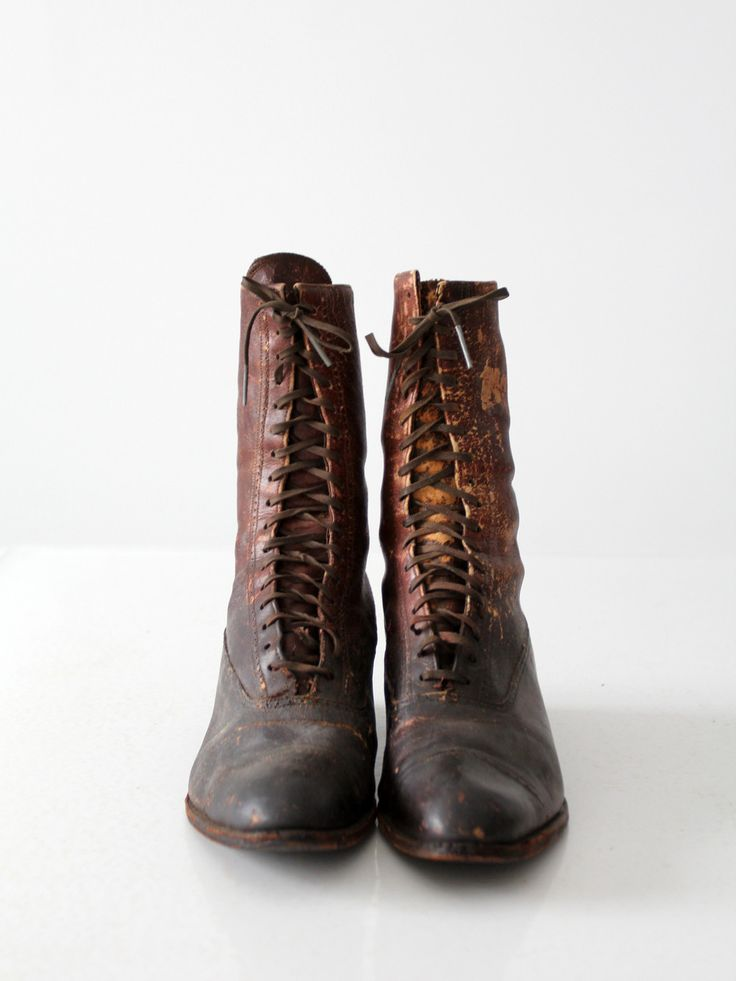 late 1800s to early 1900s This is a pair of late Victorian era boots. Beautifully aged, brown leather shapes the lace up boots. They feature wood stacked heels. - brown leather shoes - lace up boots -
