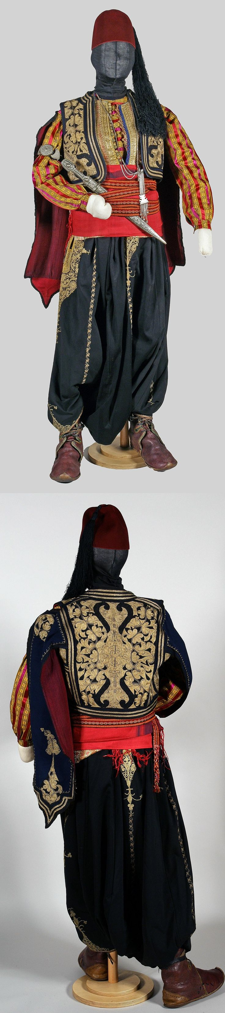 Costume of a bodyguard/coachman. Istanbul, c. 1900. Silk shirt and bodice; embroidered large trousers and jacket 'with eagle sleeves' (metallic thread & black silk on combing wool); red silk 'kuşak' (belt); woollen 'carpana kemer' (card woven waist band); leather 'postal' boots; silver: 'kama' (Caucasian straight dagger), 'köstek sallaması' (watch chain with plaquette) and 'pazubent' (amulet-armband). (Kavak Costume Collection-Antwerpen/Belgium). (SOLD to the 'Etnografisch Museum…