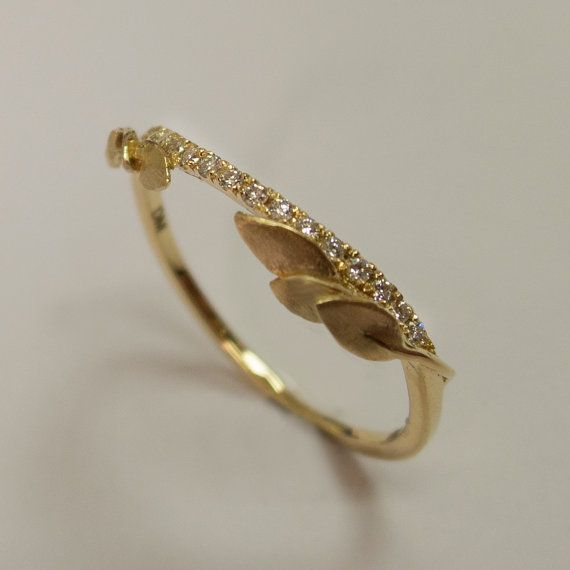 A handmade 14k gold leaves ring set with 15 clear little diamonds.    This ring in the pictures is set with 1mm clear diamonds but can be set with any