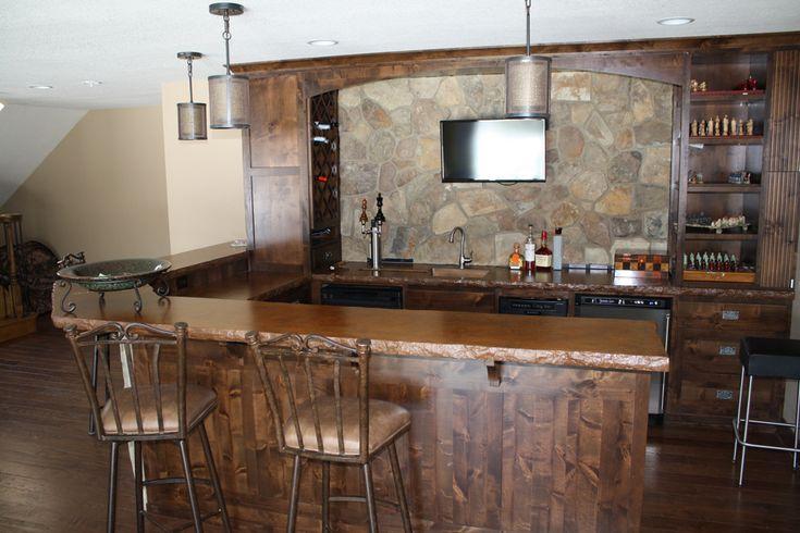 Mixed acid stain color, broken rock edge concrete basement bar countertops.