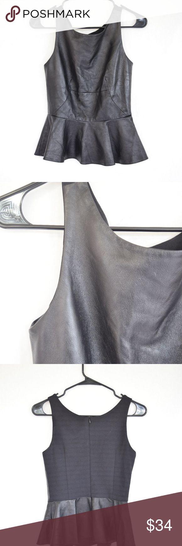 Amanda Uprichard Martini Peplum Top (Sz XS) Amanda Uprichard Martini Leather Peplum Top (Sz XS) Black peplum sleeveless top with contrasting rayon back. Some softening & wear from use. Amanda Uprichard Tops Blouses