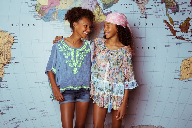 Ruby Yaya | Kids Wear. Fashion for the boho & stylish kids. Colourful, fun & comfortable dresses and Blouses.  (2 girls staring at each other with Ruby Yaya boho shirts with map in background)