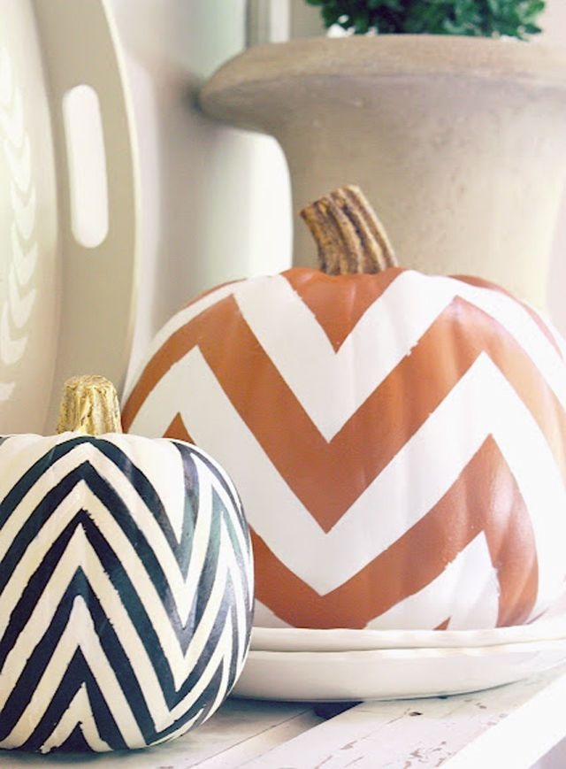 chevron pumpkins. Use painters tape or a small paint roller to paint on these Chevron like patterns onto you pumpkins. Fun for a very Beatle Juice - Geometric Halloween effect