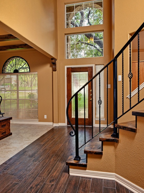 Thinking i 39 d like to exchange our basic wood railing painted spindles that chip with a simple - Wrought iron indoor decor classy elegance ...