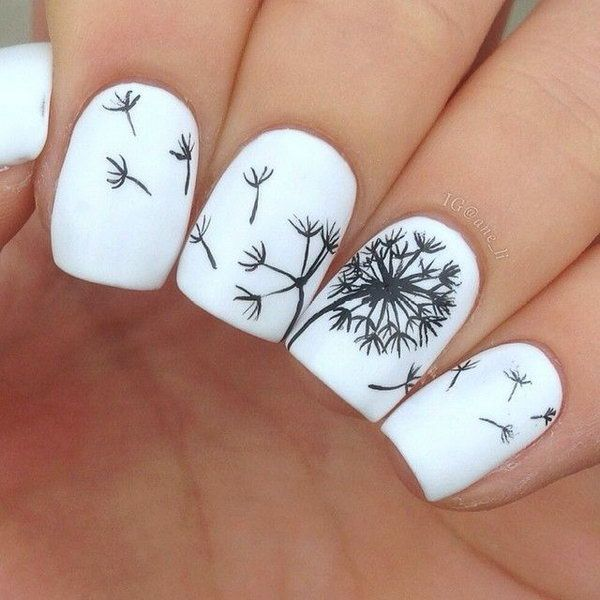 A dandelion on white nails looks so beautiful