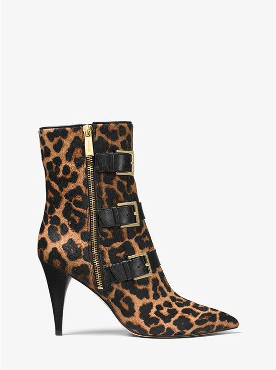 ON SALE! Michael Kors Lori Leopard Calf Hair Mid-Calf Boot. Rendered in rich leopard-print calf hair, our Lori mid-calf boots channel a luxe rock 'n' roll attitude. This pointed-toe pair is detailed with leather buckle straps and a sleek stiletto heel. Wear them to bring a touch of insouciant edge to mini skirts and slip dresses.