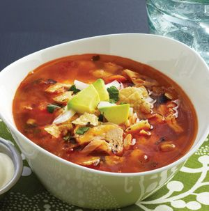 A bowl full of this Posole Chicken Soup will cure whatever ails you. Throw hominy, shredded chicken and a chipotle pepper in a pot with some broth and you've got hot and filling soup in about 30 minutes.