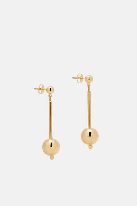 "Sophie Buhai creates jewelry that is at once sculptural and classic. She describes these lightweight drop earrings as ""slightly Bauhaus, slightly Memphis, and a little bit pomo."" Handmade in Los Angeles of 14-karat gold, they suspend gleaming orbs along delicate rods that dangle from smaller hemispheres. For pierced ears."
