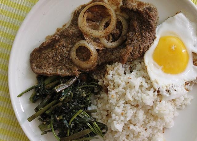Filipino breakfast: bisteksilog (beef steak, fried rice, egg) + garlic kangkong (swamp cabbage)