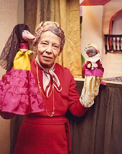 Pura Belpré (1899–1982) was the first Puerto Rican librarian in New York City. She was also a writer, collector of folktales, and puppeteer. There is some dispute as to the date of her birth which has been given as February 2, 1899, December 2, 1901 and February 2, 1903.