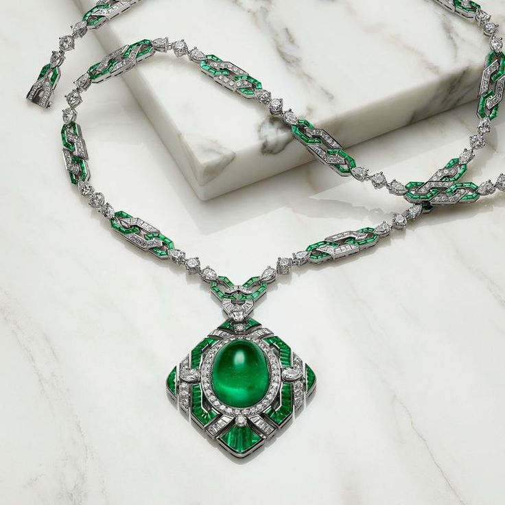 Named The Green Liz as it is reminiscent of the necklace Richard Burton gave to Liz Taylor on her 40th birthday, this cabochon emerald high jewellery necklace from Bulgari's Festa collection is set in platinum and covered in white diamonds. http://www.thejewelleryeditor.com/shop/product/bulgari-festa-royal-ballroom-emerald-high-jewellery-necklace/ #jewelry