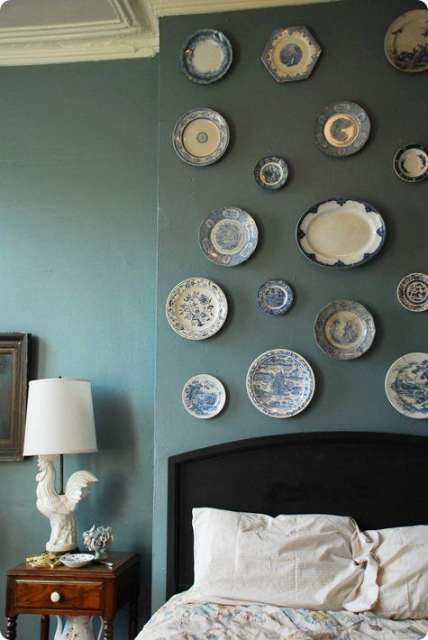 Plates above the headboard? Just make sure they're fastened securely to avoid a rude awakening.