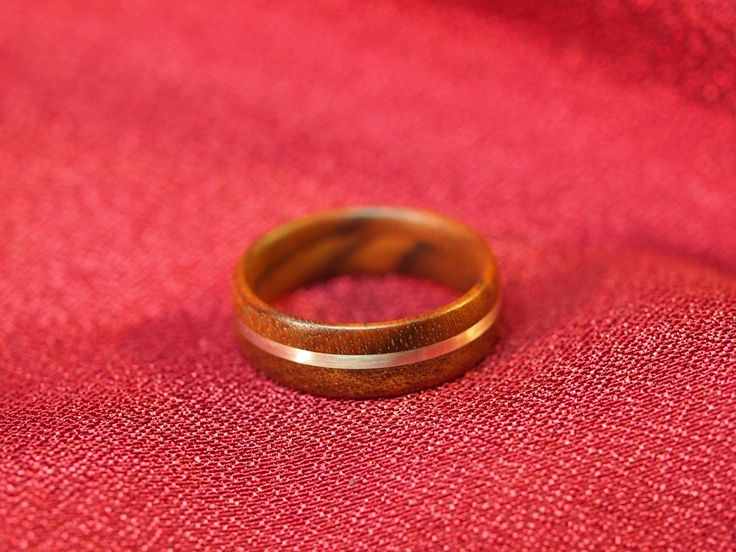 Handmade wooden ring from walnut and silver.