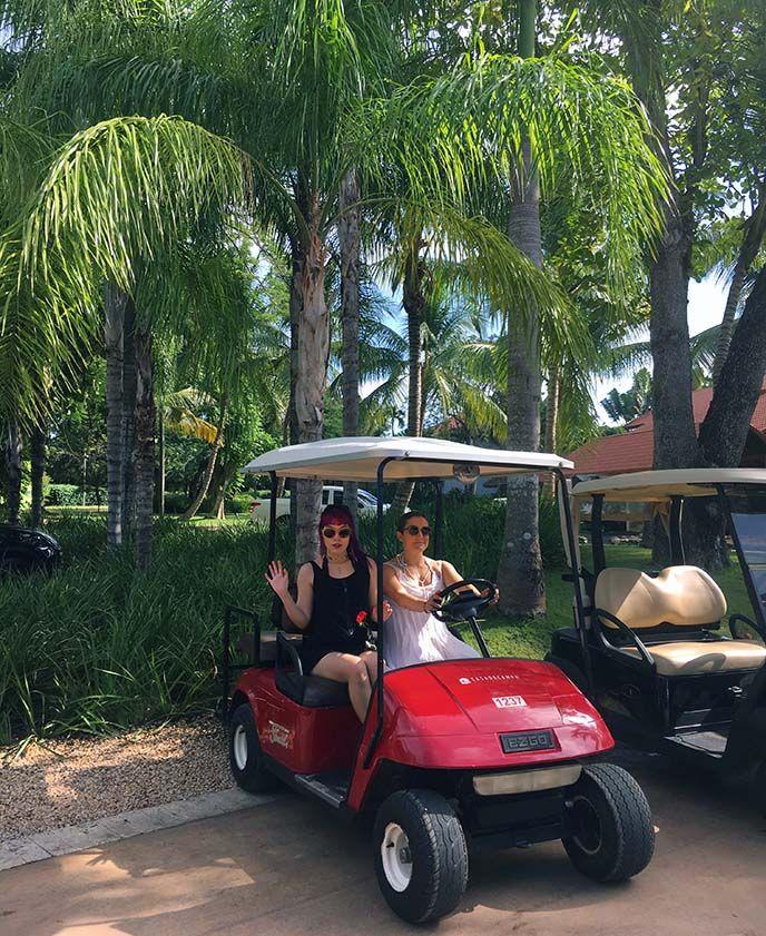 golf carts resort Caribbean, casa de campo golf courses teeth of dog, girls driving golf cart, red golf car tropical dominican republic hotel. more at lacarmina blog http://www.lacarmina.com/blog/2018/02/casa-de-campo-resort-review-dominican-republic-luxury-hotel/