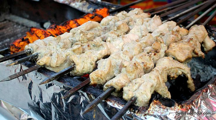 Mouth watering tikka kebabs cooked over charcoal fire  http://DelhiFoodTour.com