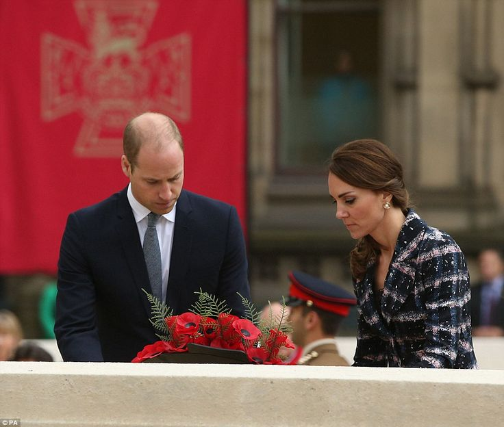Kate and William look sombre as they lay a wreath at the Cenotaph in Manchester...