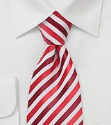 Tie-a-Tie.net  Great site with videos to teach you how to tie the Windsor, Half Windsor, Pratt and Four in Hand (the one most people know).