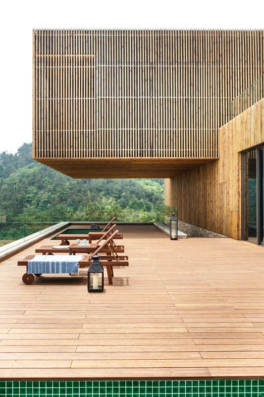 Overhang above the pool terrace, Spa-Clubhouse at Garden Valley - Mei Jie Mountain Hotspring resort in Liyang, China. by AchterboschZantman architecten #slats #wood #overhang #bamboo #forest #shutters #pool www.meijieresort.com