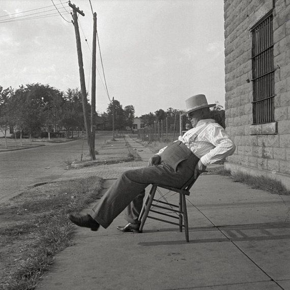 Oklahoma art print, 1936.The sheriff of McAlester, Oklahoma, sitting in front of the jail. He has been sheriff for 30 years.Oklahoma poster.