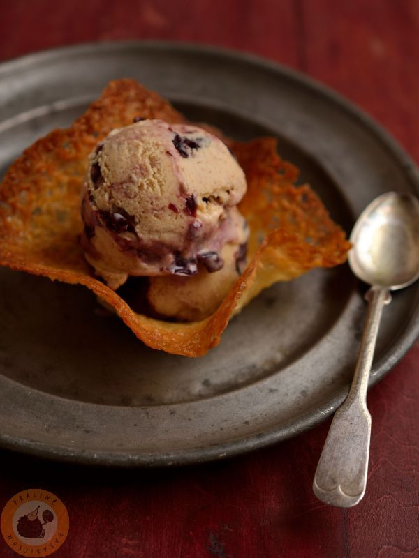 Almond & sour cherry ice cream in coconut tuile cup
