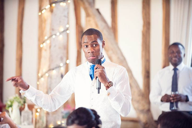 Usher at Clock barn making speeches. Photography by one thousand words wedding photographers www.onethousandwords.co.uk