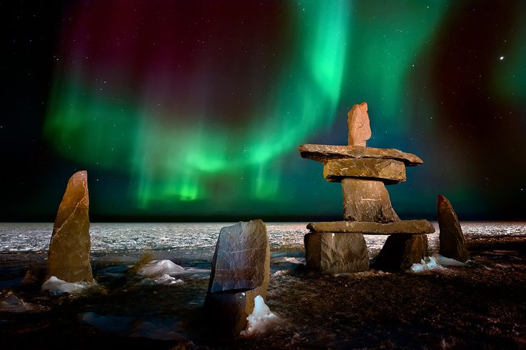 Northern Lights Over The Inukshuk in Churchill, Manitoba, Canada. Photo by Steve Perry.