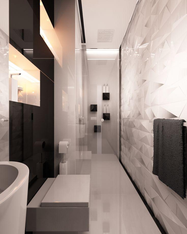 toaleta utrzymana czarno- białych kolorach.Powściągliwość w kolorystyce równoważy bogata forma  - mebli , kafli ściennych