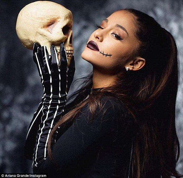 Vampy look: The former Nickelodeon star held onto a skull for an Instagram photo, adding striped gloves and a long sleeved black top