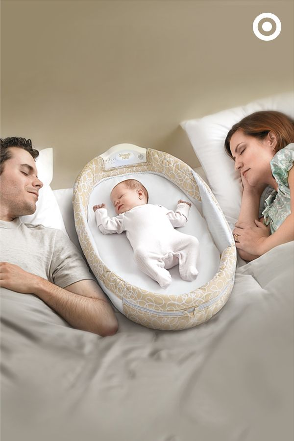 Keep your newborn safe, snug and close during nap time and bedtime. The Baby Delight Snuggle Nest Napper with Surround Sound features protective walls to keep Baby from rolling, plus cushioning foam for comfort. What's more, a built-in speaker plays soothing sounds, lulling your little one (and you) to sleep.